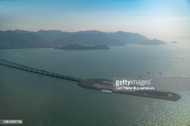South China Sea, Lantau Island and Hong Kong-Zhuhai-Macao Bridge in Hong Kong daytime aerial view from airplane