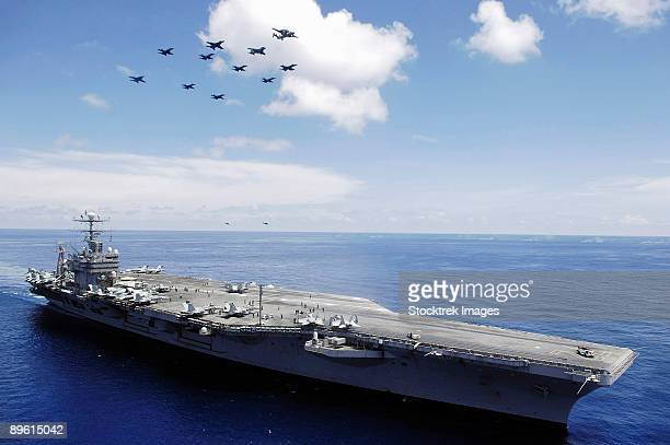 South China Sea, May 8, 2006 - The Nimitz Class Carrier USS Abraham Lincoln, and aircraft from Carrier Air Wing 2 perform a aerial demonstration in the South China Sea.