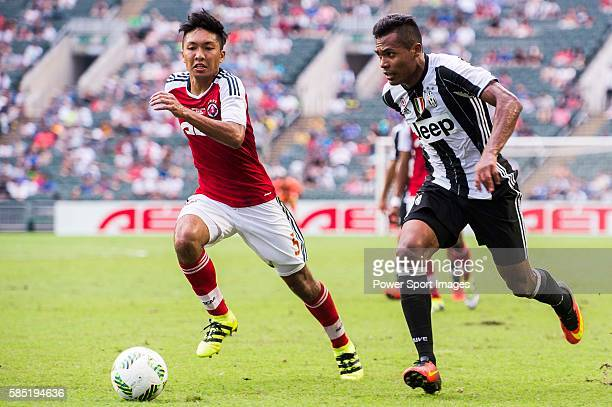 South China's player Chak Ting Fung contests the ball against Juventus' player Alex Sandro during the South China vs Juventus match of the AET...