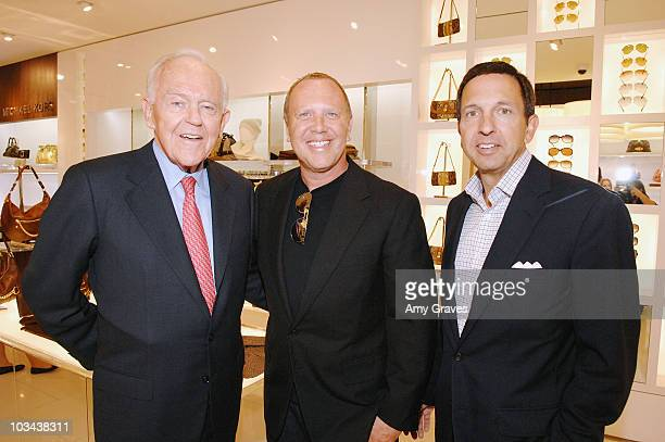 South Coast Plaza Owner Henry Segerstrom Fashion designer Michael Kors and CEO of Michael Kors John Idol attend the opening of the Michael Kors Store...