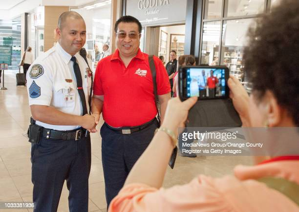 South Coast Plaza security guard Ramon Mateo is photographed with a Chinese visitor in Orange County for a business convention When asked why they...
