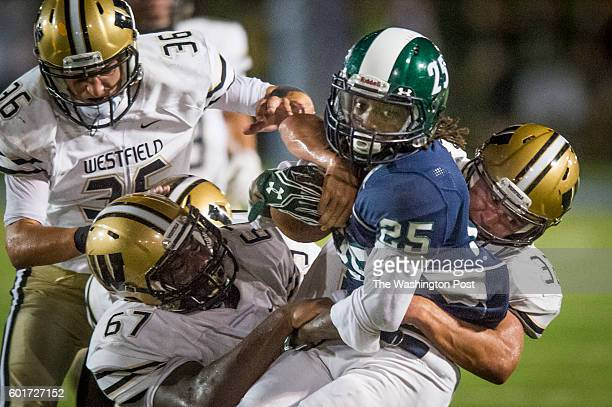 South County running back Tyler Johnson is pulled down by a gang of Westfield players during second quarter action at South County Secondary School...