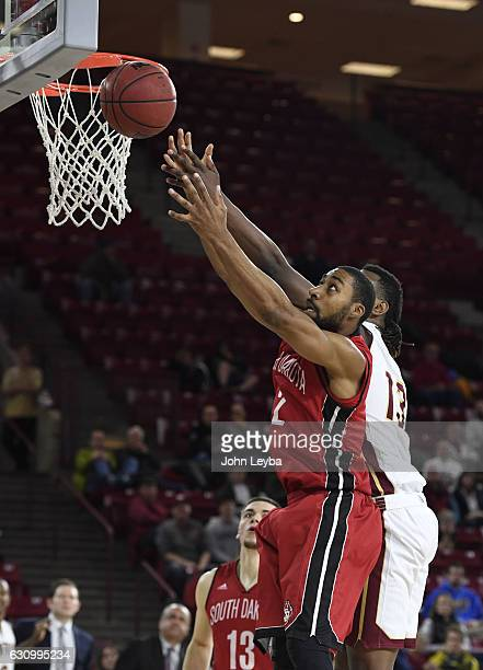 South Dakota Coyotes guard Carlton Hurst battles for a rebound with Denver Pioneers forward CJ Bobbitt during the second half January 4 2017 at...