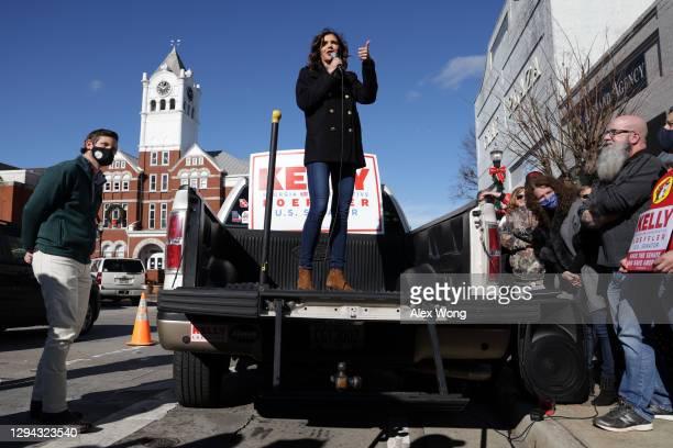 South Dakota Gov. Kristi Noem speaks as she campaigns for U.S. Sen. Kelly Loeffler during a campaign event outside Gritz Family Restaurant January 3,...