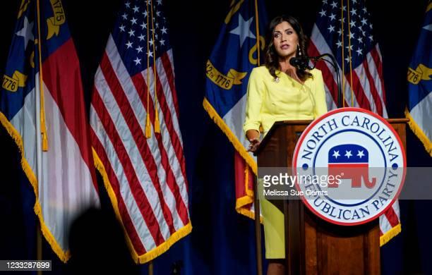 South Dakota Gov. Kristi Noem speaks to attendees at the North Carolina GOP convention on June 5, 2021 in Greenville, North Carolina. Former U.S....