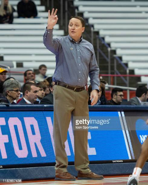South Dakota State Jackrabbits Head Coach Aaron Johnston signals the play to his players on the court during the first half of the game between the...