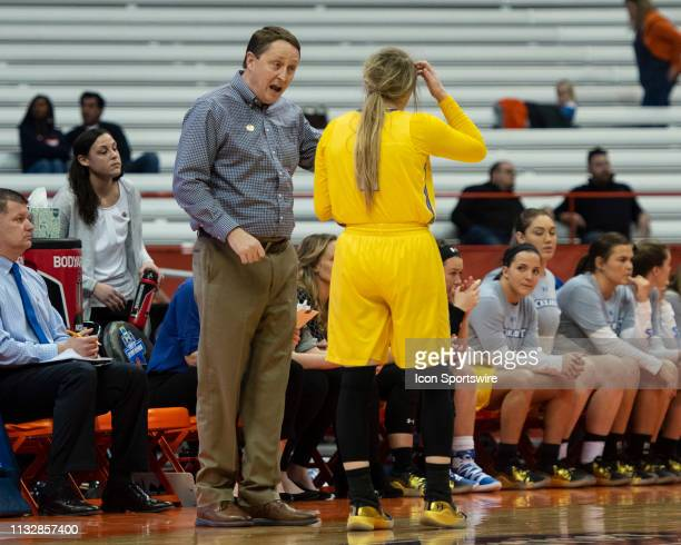 South Dakota State Jackrabbits Head Coach Aaron Johnston speaks with South Dakota State Jackrabbits Guard Madison Guebert during the first half of...
