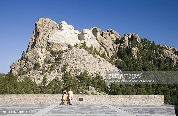 USA, South Dakota, tourists watching Mount Rushmore National Memorial, close-up
