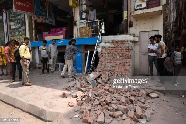 South Delhi Municipal Corporation demolished encroachments during an antiencroachment drive at Dakshinpuri near Pushpa Bhawan road on May 31 2018 in...