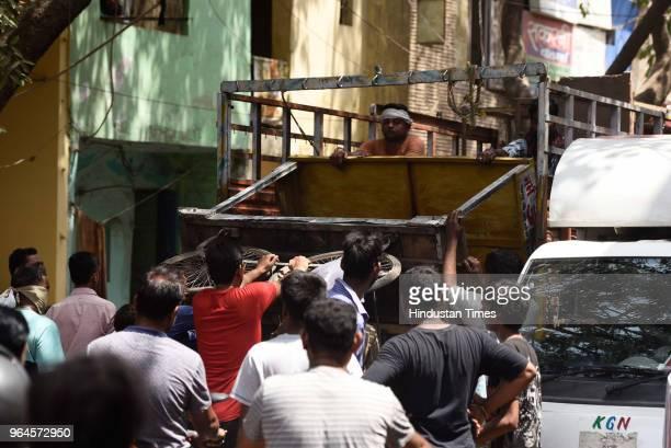 South Delhi Municipal Corporation officials remove illegal makeshift stalls during an antiencroachment drive at Dakshinpuri near Pushpa Bhawan road...