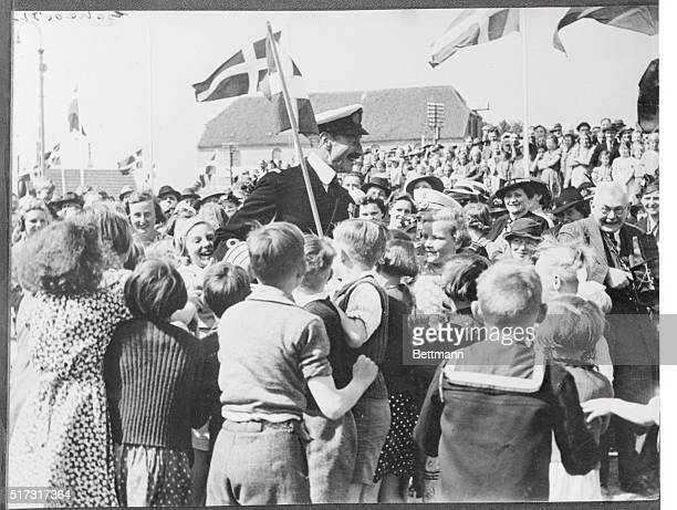 South Jutland's Welcome To King Of Denmark King Christian of Denmark smiles broadly as a crowd of children press around him during his welcome to...