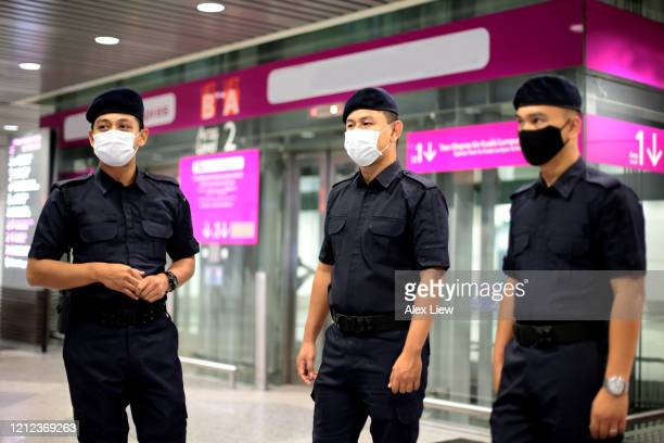 south east asia: at the airport - malaysian culture stock pictures, royalty-free photos & images