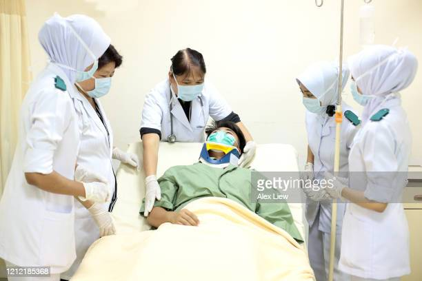 south east asia: at the hospital - human nervous system stock pictures, royalty-free photos & images