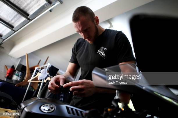 South East Melbourne Phoenix player Mitchell Creek works on his bike after training in isolation at home due to the coronavirus lockdown on May 14,...