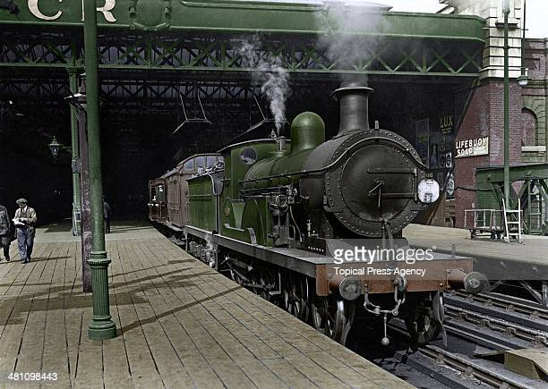 A South Eastern Chatham Railways locomotive at Charing Cross Station London January 1924 Image colourized by David P Williams