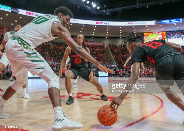 South Florida Bulls forward Alexis Yetna and Houston Cougars guard Dejon Jarreau reach to win the ball during the basketball game between the South...