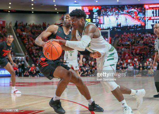 South Florida Bulls forward Alexis Yetna drives the ball past Houston Cougars forward Cedrick Alley Jr during the basketball game between the South...