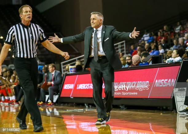 South Florida Bulls head coach Brian Gregory complains to referee Rick Crawford during the college basketball game between the South Florida Bulls...