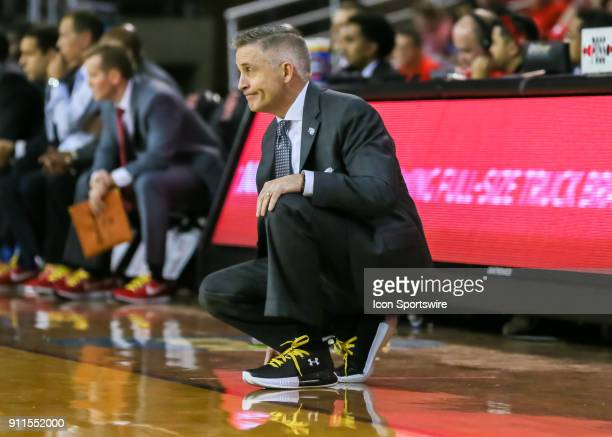 South Florida Bulls head coach Brian Gregory watches a play during the college basketball game between the South Florida Bulls and Houston Cougars on...