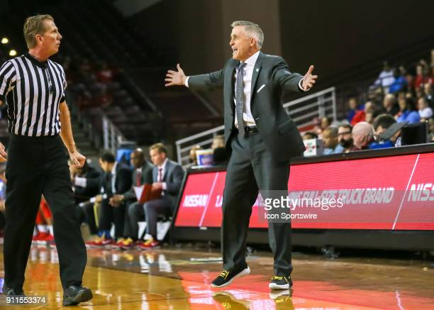 South Florida Bulls head coach Brian Gregory yells at Referee Rick Crawford during the college basketball game between the South Florida Bulls and...