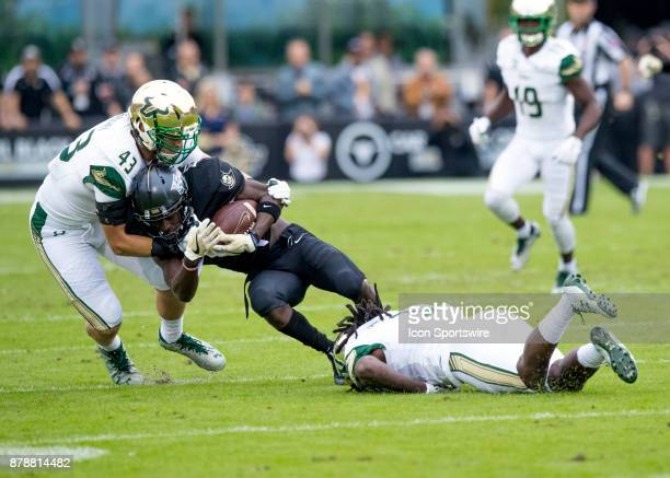 South Florida Bulls linebacker Auggie Sanchez makes an open field tackle during the football game between the UCF Knights and USF Bulls on November...