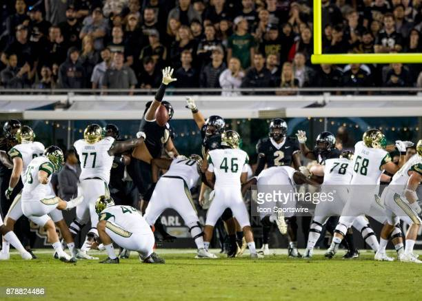 South Florida Bulls place kicker Emilio Nadelman kicks the extra point during the football game between the UCF Knights and USF Bulls on November 24...