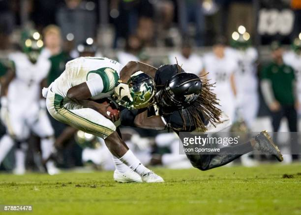 South Florida Bulls quarterback Quinton Flowers gets sacked by UCF Knights linebacker Shaquem Griffin during the football game between the UCF...