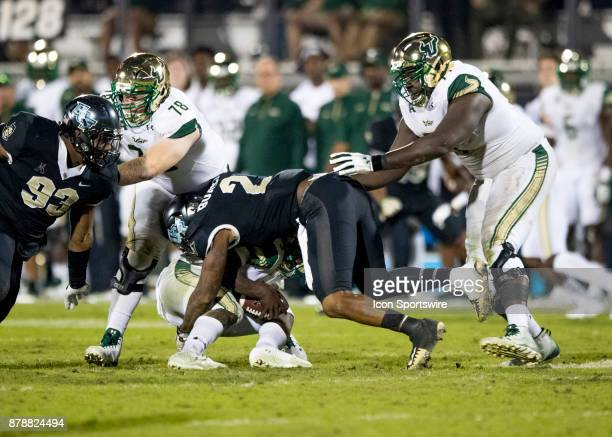 South Florida Bulls quarterback Quinton Flowers gets sacked by UCF Knights linebacker Chequan Burkett during the football game between the UCF...