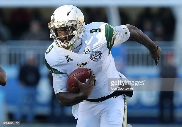 South Florida Bulls quarterback Quinton Flowers looks for an opening during the 2016 Birmingham Bowl between the South Carolina Gamecocks and South...