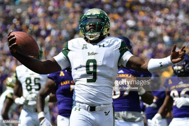 South Florida Bulls quarterback Quinton Flowers runs with the ball during a game between the South Florida Bulls and the East Carolina Pirates at...