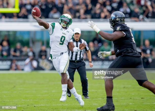 South Florida Bulls quarterback Quinton Flowers throws for a first down completion during the football game between the UCF Knights and USF Bulls on...