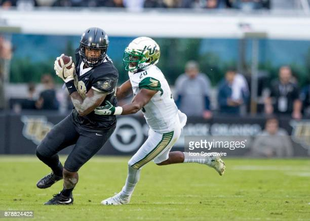 South Florida Bulls safety Devin Abraham makes a tackle during the football game between the UCF Knights and USF Bulls on November 24 2017 at Bright...