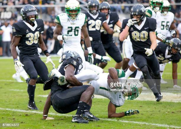 South Florida Bulls wide receiver Chris Barr gets tackled on his punt return during the football game between the UCF Knights and USF Bulls on...