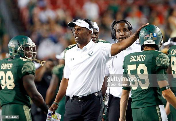 South Florida head coach Willie Taggart celebrates with his team after a first quarter touchdown against the Navy Midshipmen at Raymond James Stadium...
