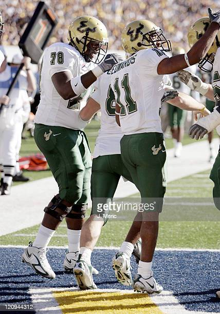 South Florida players celebrate after quarterback Matt Grothe's touchdown during the game between South Florida and West Virginia at Milan Puskar...