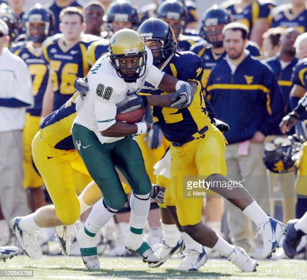 South Florida receiver Ean Randolph looks to break the tackle of West Virginia's Ridwan Malik during the game between South Florida and West Virginia...
