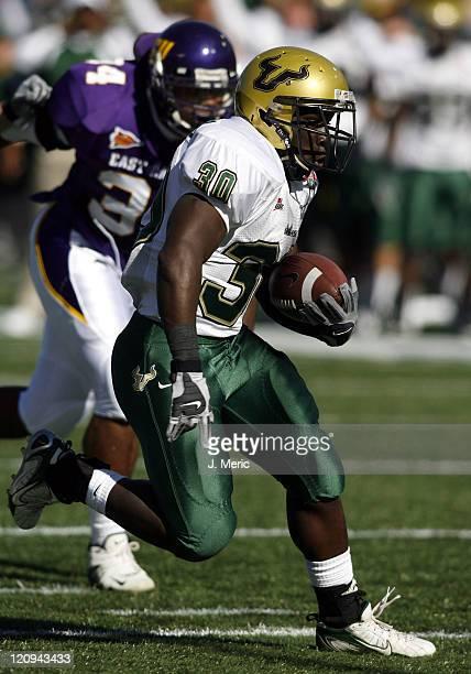 South Florida tailback Benjamin Williams looks for some yardage in Saturday's PapaJohnscom Bowl against East Carolina at Legion Field in Birmingham...