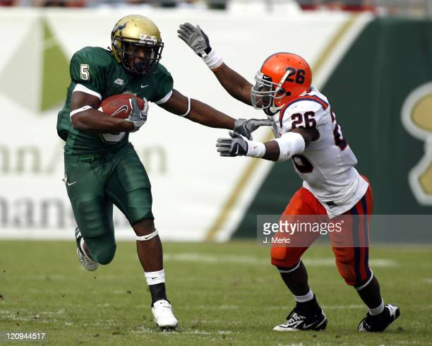 South Florida tailback Ricky Ponton makes it past Syracuse defender Dowayne Davis during Saturday's action at Raymond James Stadium in Tampa Florida...