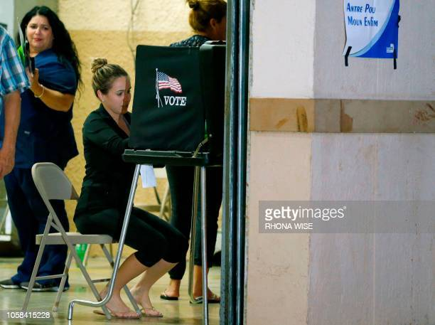 South Florida voters cast their vote late in the day at a busy polling center in Miami Florida on November 6 2018
