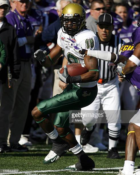 South Florida's Amarri Jackson looks to elude a would be tackler from East Carolina during Saturday's Papajohnscom Bowl at Legion Field in Birmingham...