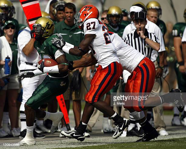 South Florida's Amarri Jackson makes it to the sideline as a pair of Syracuse defenders meet him there during Saturday's game at Raymond James...