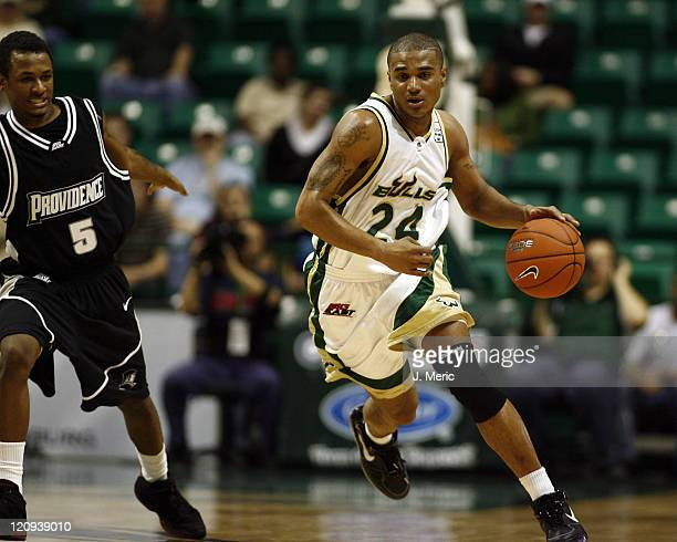 South Florida's Chris Howard looks to drive the ball around Providence College's Dwain Williams during Wednesday night's game at the Sundome in Tampa...
