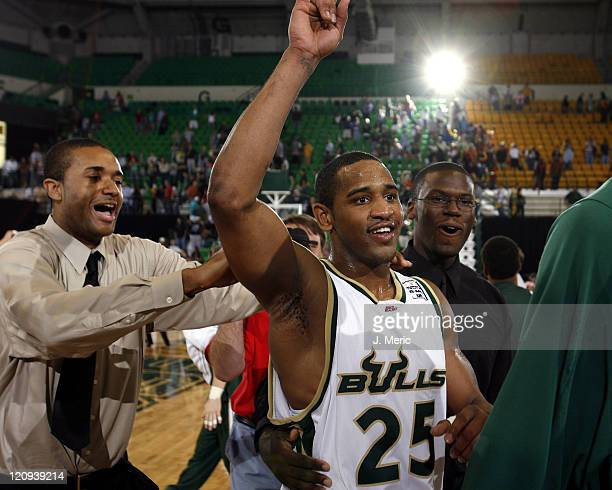 South Florida's James Holmes celebrates his team's upset victory over Georgetown during Saturday's game at the Sundome in Tampa, Florida on March 4,...