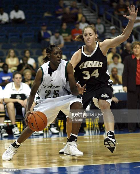 South Florida's Jessica Dickson drives around Vanderbilt's Christina Wirth during Sunday's action at the St Pete Times Forum in Tampa Florida on...