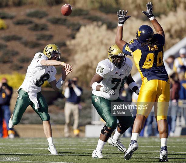 South Florida's Matt Grothe looks for an open receiver as West Virginia's Warren Young attempts to knock down his pass during the game between South...