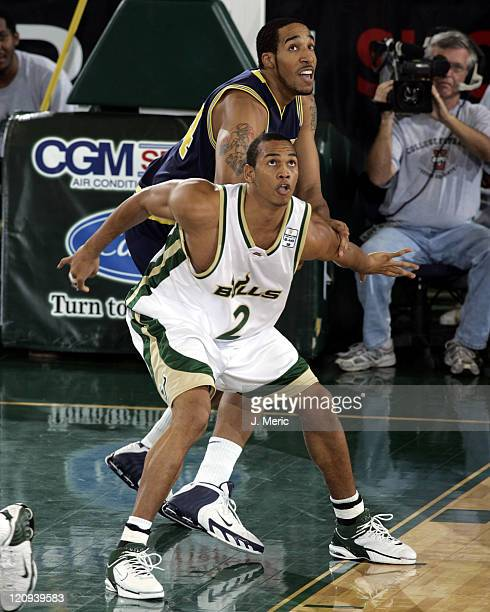 South Florida's Melvyn Richardson boxes out Michigan's Courtney Sims during Saturday's game at the Sundome in Tampa, Florida on December 10, 2005.