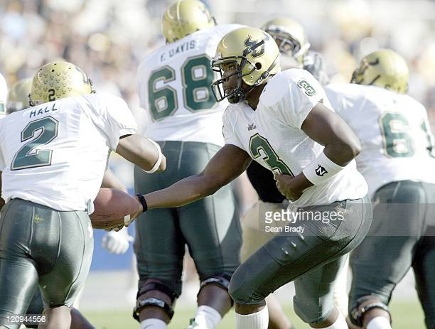 South Florida's Pat Julmiste hands off to Andre Hall during action against the Pittsburgh Panthers at Heinz Field in Pittsburgh Pennsylvania on...