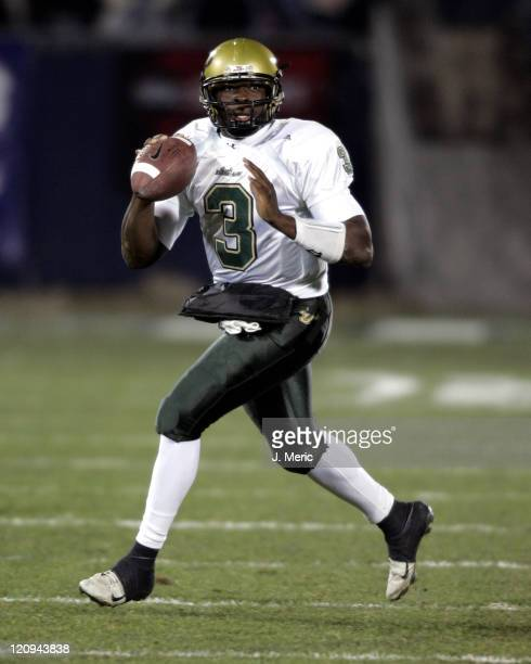 South Florida's Pat Julmiste looks down field for an open receiver in Saturday's game against the University of Connecticut at Rentschler Field in...