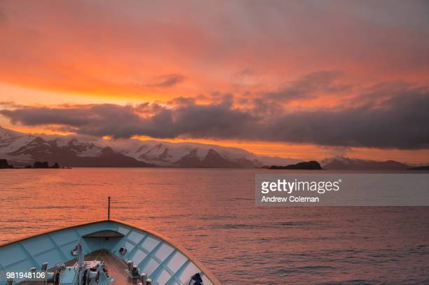 A sunset, as seen from a ship's bow.