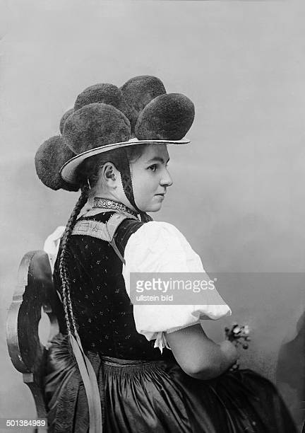 woman from the Gutach Valley in traditional Sunday costume wearing a socalled 'Bollenhut' hat around 1910